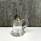 Antique glass spirit lamp with applied handle