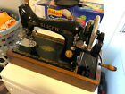 Vintage Singer sewing machine in portable cabinet