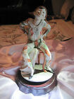 Paradies Collectible Musical Turning Court Jester sitting on chair- 12.5