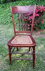 ANTIQUE VINTAGE OAK CARVED SPINDLE BACK ~CANE SEAT~ WOOD CHAIR ~ EARLY 1900's??