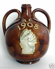 ROYAL DOULTON GREENLEES BROTHERS CLAYMORE SCOTCH WHISKY INDIAN FLASK JUG AC 1908