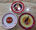 Set of 3 different Coca Cola 10.5 inch collector plates.  Gibson