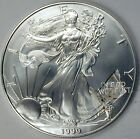 1999 BU SILVER AMERICAN EAGLE OBVERSE STRUCK THRU RETAINED PLASTIC ERROR COIN