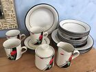 SANGO ANTHURIUM 927 JOAN LUNTZ Place setting for 4_23 pieces plates mugs bowls +