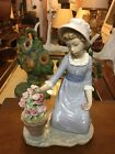 lladro figurine girl with flowers