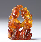 Antique Chinese Amber Carving of Two Figures Seated with Book and Bird