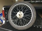 1977/78 Kawasaki KE125 Front wheel and tire complete with spindle and brake