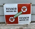 TEXACO MOTOR OIL AGAINST HEAT COLD INSULATED PORCELAIN ENAMEL METAL GAS AD SIGN
