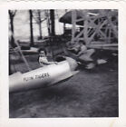 Circa 1940s Snapshot Photo of Little Girl Riding in Airplane Swing Flyin Tigers