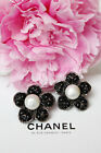 CHANEL Beautiful flower shaped clip on earrings with black glass paste