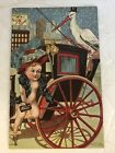 Antique P Sander NY 1906 New Years Post Card Stork Baby Father Time