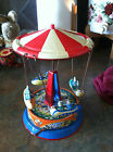 2 Colorful  tin swing carousels   Made in West Germany. small one made in china