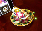 SEALY 3 FOOTED FRUIT LEAF HANDLE IRIDESCENT DEMITASSE LATTICE  CUP AND SAUCER