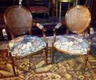 PAIR OF OVAL MAHOGANY FRENCH LOUIS XVI FLORAL PRINT CANE BACK CHAIRS