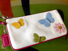COACH RARE LEATHER BUTTERFLY AND FLOWER APPLIQUE WRISTLET CLUTCH