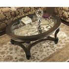 Ashley Furniture Norcastle Oval Coffee Table in Dark Brown