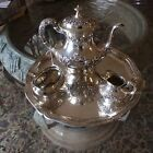 An American Gorham Sterling Silver Three-Piece Coffee Set and A German tray