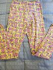 LuLaRoe Girls Tween Lggings Multicolored Yellows Purples Good Used Condition.