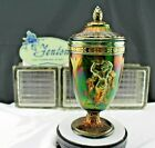 Favrene Glass Dancing Ladies Urn  Lid was made by Fenton Art Glass