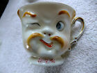 VINTAGE DEMI TASSE CUP AND SAUCER WITH 3D FACE ON CUP PRETTY NEAT