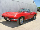 Chevrolet  Corvette CONVERTIBLE 1966 corvette 427 390 hp 4 speed roadster with hardtop factory red red