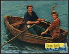 True as a Turtle Lobby Card-John Gregson and June Thorburn rowing a boat.
