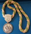ODD FELLOW MEDAL WITH GOLD AND GREEN ROPE CHAIN