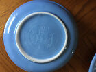 4 blue and 1 yellow Fiestaware dishes