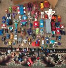Lot Of Over 60 1980s Transformers Figures Parts Extras Papers