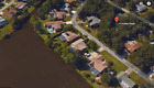 BEAUTIFUL PORT CHARLOTTE FLORIDA BUILDING LOT ACROSS FROM LARGE LAKE AND CANAL