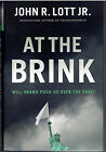 At The Brink  Will Obama Push Us Over the Edge by John R Lott Jr SIGNED