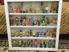 Simpson Action Figures in wooden cases with glass fronts. Pee Wee Herman too
