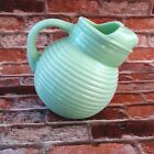 Jadeite Ribbed Tilt Ball Pitcher With Ice Guard Reproduction
