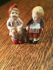 Vintage Boy and Girl Sitting Ceramic Salt and Pepper Shakers JAPAN