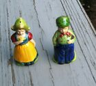 VINTAGE JAPAN MAN IN JEANS AND WOMAN HOLDING FLOWER SALT AND PEPPER SHAKERS