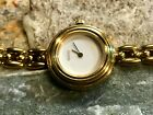 GUCCI LADIES  11 / 12.2  GOLD BEZEL VINTAGE WRISTWATCH WITH WHITE DIAL
