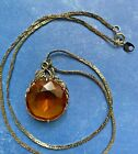 Vintage Large Amber colored Pendant with 22 inch Silver Tone Necklace
