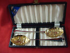 TWO SILVERPLATE SERVING SPOONS WITH GOLD WASH EMBOSSED BOWLS WITH  FRUIT DESIGN