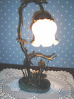 BRASS ACCENT TABLE LAMP, CHERUB ON SWING,MARBLE PLINTH,WHITE RUFFLED GLASS SHADE