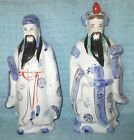 Pair of Porcelain Figurines of Two Bearded Asian Men in Robes