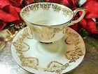 PARAGON TEA CUP AND SAUCER ELEGANT WHITE  GOLD FLORAL AND LACE TRIM