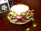 ROYAL SEALY 3 FOOTED FRUIT LEAF HANDLE IRIDESCENT DEMI LATTICE  CUP AND SAUCER