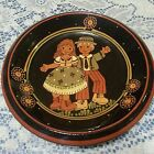 Clay Plate / Wall Hanging Black with Bavarian Girl & Boy Handpainted Signed Isis
