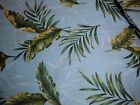 100% Cotton Tropical Leaves on blue Fabric with bamboo in background sbt yard