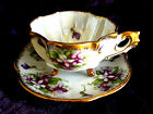 NAPCO HP DEMITASSE QUATRAFOIL PURPLE VIOLETS 3 FOOTED IRIDESCENT CUP AND SAUCER