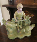 Adorable Antique German Bisque Porcelain Boy wth Geese Piano Baby Figurine