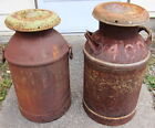 pair of rusty old milk cans primitive dairy farm decor