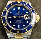 ROLEX SUBMARINER 40MM 16613 18K YG/STEEL BLUE BEZEL & DIAL W/ CARD - UNPOLISHED