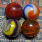 4 Akro marbles including an oxblood brick (NM, played with)