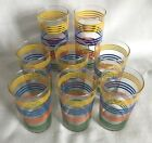8 VINTAGE GLASS TUMBLERS WITH YELLOW, BLUE, ORANGE, GREEN BANDED RINGS